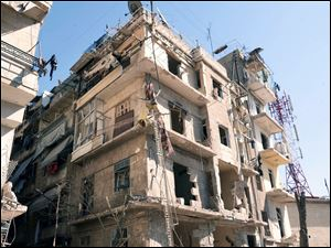 This photo released by the Syrian official news agency SANA shows a damaged building after a blast in Aleppo, Syria.