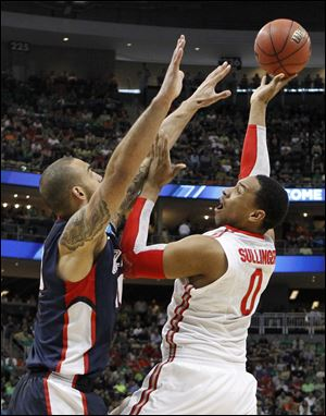 Jared Sullinger shoots over Gonzaga's Robert Sacre. Sullinger scored 18 to lead the Buckeyes to a regional semifinal on Thursday.