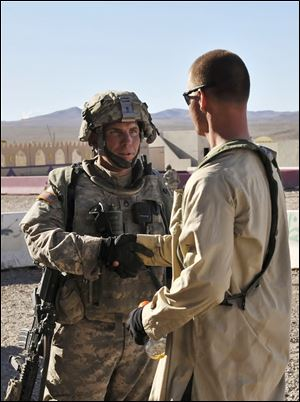 Sgt. Robert Bales, left, struggled to make payments on his home and had planned to leave the military after being denied a promotion.