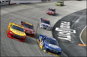Brad Keselowski (2) and AJ Allmendinger (22) drive during the NASCAR Sprint Cup Series auto race in Bristol, Tenn.