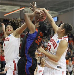 Ohio State defenders Kalpana Beach, left, and Ashley Adams, try to stop Florida's Jennifer George from shooting.