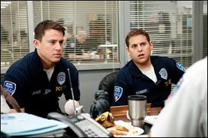 "In this image released by Columbia Pictures, Channing Tatum, left, and Jonah Hill are shown in a scene from the film ""21 Jump Street."""