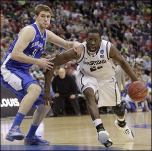 Michigan State's Draymond Green, right, drives the lane past Saint Louis' Rob
