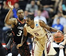 NCAA-Cincinnati-Florida-St-Basketball-Yancy-NCAA-Cincinnati-Florida-St-Basketball-Yancy-Gates-Bernard-JamesGates-Bernard-James