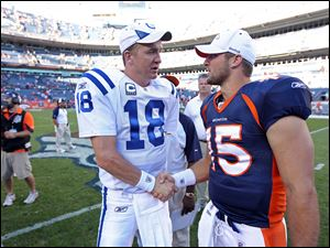 Peyton Manning, left, is negotiating to join the Broncos, ESPN reported Monday, which could lead to the ouster of quarterback Tim Tebow, right.