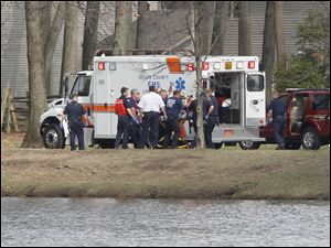 Rescue personnel move a possible drowning victim to an ambulance at Olander Park in Sylvania.