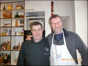 Dan Neman smiles with chef Olivier Berte.