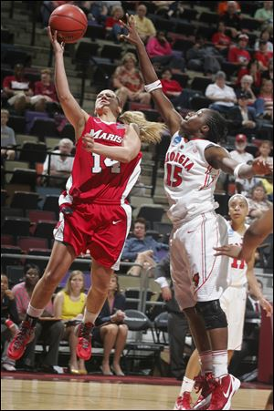 Marist's Casey Dulin, left, goes up for a layup against Georgia's Krista Donald in the second half. Marist beat Georgia 76-70.