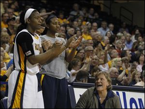 From left: UT's Lecretia Smith, Taylor Carver and Mariah Carson and head coach Tricia Cullop celebrate a play.