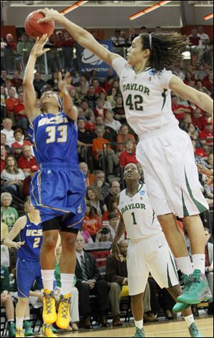 Baylor's Brittney Griner blocks a shot of UC Santa Barbara's Destini Mason in a NCAA tournament game at BGSU. Griner was the defensive player of the year last year and has more blocks this season.