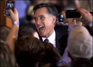 Republican presidential candidate, former Massachusetts Gov. Mitt Romney reacts while greeting supporters at a rally in Schaumburg, Ill., after the winning the Illinois Republican presidential primary, Tuesday.
