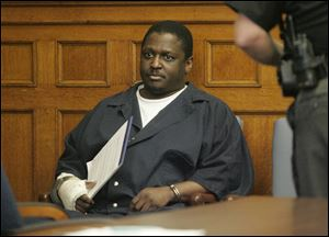 Wayne Powell awaits sentencing in Common Pleas Court Sept. 13, 2007. Convicted of aggravated murder and aggravated arson, he received four death sentences for a fire that killed four members of a family at 814 St. John Ave. in 2006.