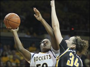 Toledo center Brianna Jones (50) goes to the net against Virginia's center Chelsea Snyder (34).