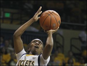 University of Toledo guard Andola Dortch (22) goes to the net against VCU guard Andrea Barbour (15).