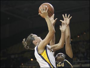 University of Toledo guard Courtney Ingersoll (2) goes to the net against  Virginia Commonweatlh forward Courtney Hurt (44) .