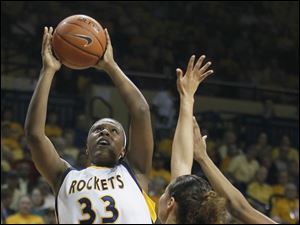 University of Toledo center Yolanda Richardson (33) shoots over VCU players at Savage Arena.
