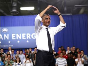 President Barack Obama starts the traditional O-H-I-O cheer after speaking at The Ohio State University in Columbus.