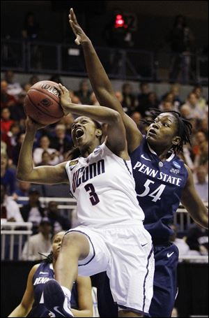 UConn's Tiffany Hayes gets by Penn St.'s Nikki Greene during the first half of the Huskies' win.