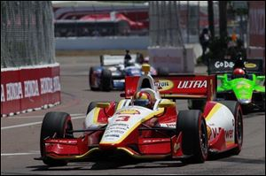 Helio Castroneves leads during the IndyCar Series' Honda Grand Prix auto race in St. Petersburg,