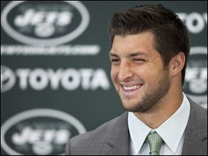 Tim Tebow holds his first news conference with the New York Jets, Monday in Florham Park, N.J.