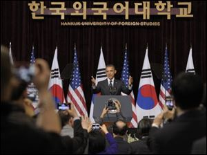 President Barack Obama arrives to speak at Hankuk University in Seoul, South Korea. Obama discussed his Prague agenda to stop the spread of nuclear weapons and seek the peace and security of a world without them.