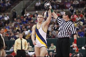Archbold's Jordan Cowell wins the Division III state title at 152 pounds. He set the Ohio record with 237 career wins.