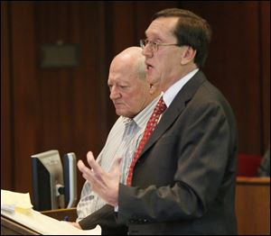 Gary Pinchoff, left, is sentenced for his animal cruelty conviction. His lawyer, William Godfroy, is with him.