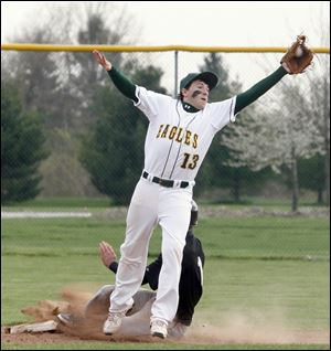 Clay High School's second baseman Matt York reaches for the ball while Perrysburg High School's  Seth Durham steals second base.
