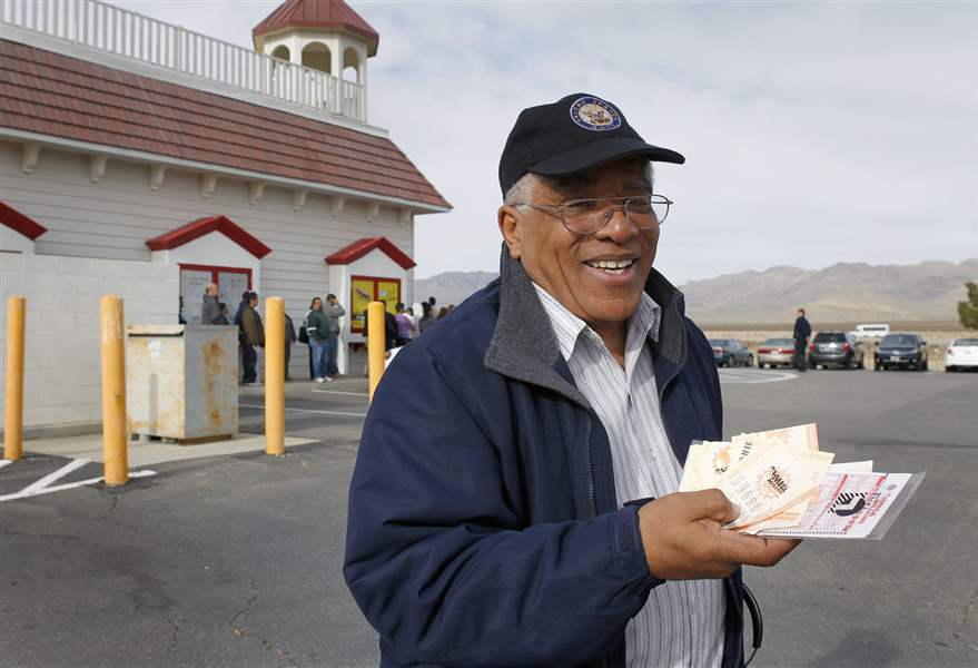 Reinaldo-Nunley-holds-his-Mega-Millions-lottery-tickets-outside-the-Primm-Valley-Lotto-Store