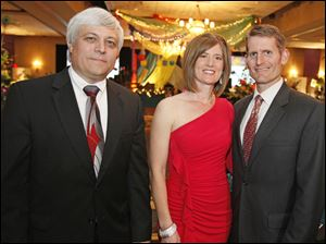 Bob Gospodarek, president and CEO of the St. Charles Hospital, left, and Angie and Brad Blandin.