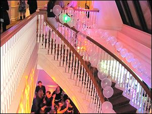 The staircase connecting the top two floors of One SeaGate was decorated to emphasis the dramatic lighting.
