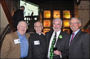 From left, Don Harbaugh, Father Ron Olszewski, President of St. Francis de Sales High School, Tom McHugh, and Mike Gibbons at the St. Francis de Sales' Knight of the Vine event.