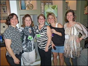 Members of the Mothers Center of Greater Toledo at the group's annual Whine and Cheese fund-raiser include, from left, Julie Winder, Brandy Davis, Tatum Buckholtz, Jackie Sheckler-Ramsdell, and Chandra Bryda.