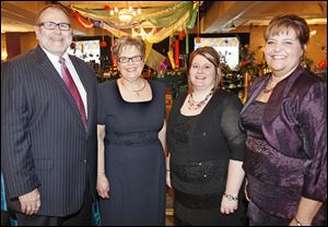 Kent Meyers at the Crystal Ball for St. Charles Hospital with event chairmen Holly Meyers, Jamie Tooman, and Amanda Caldwell.