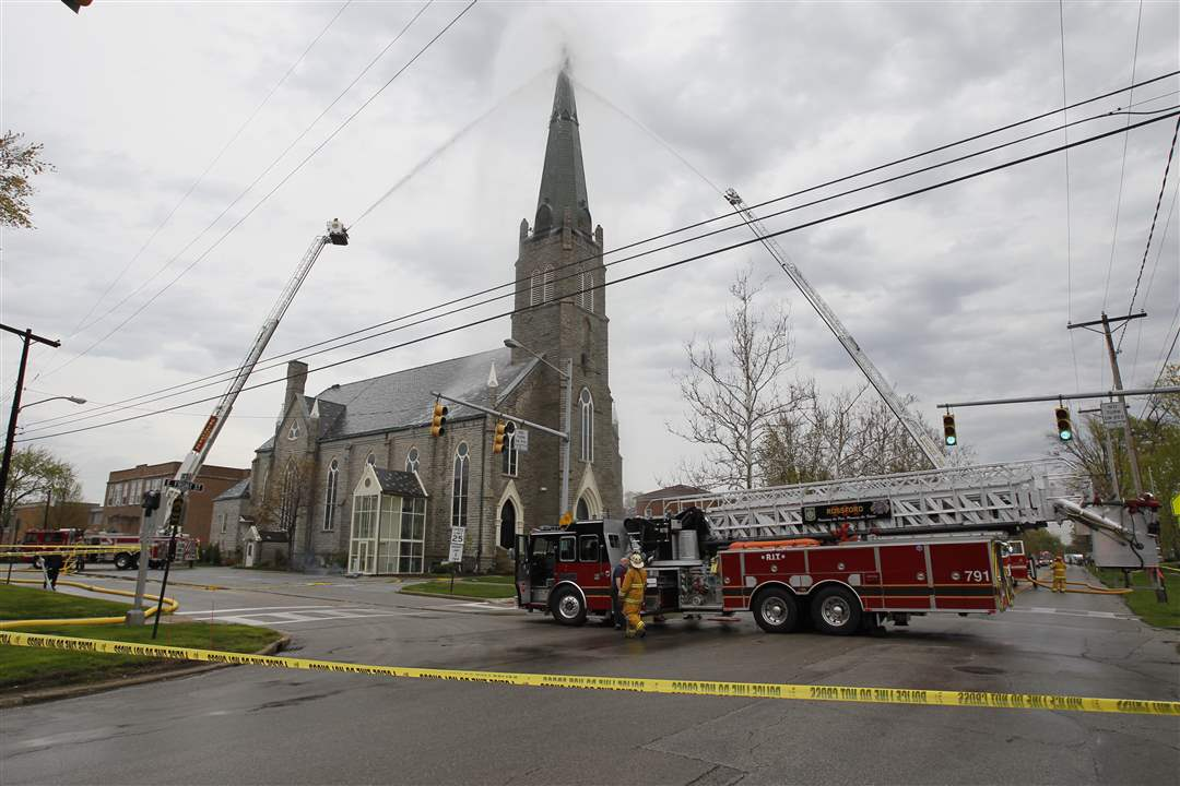 Firefighters-extinguish-a-fire-at-St-Rose-Church