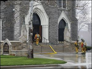 Firefighters enter St. Rose Church in Perrysburg, Tuesday, April 3, 2012.  A fire was reportedly cause by a lightning strike.