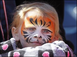 Lyla Michalak, 4, waits for the start of an exhibition baseball g