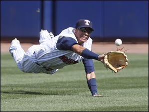Mud Hens center fielder Quintin Berry can't get a ball hit by Detroit Tigers' Curtis Casali during the ninth inning.