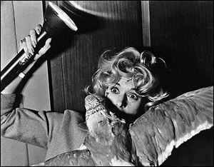 Tippi Hedren is attacked by a bird in a scene from Alfred Hitchcock's 'The Birds,' showing at the Valentine Theatre at 7:30 p.m. Friday. Admission is $5.