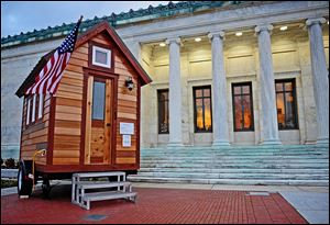 The Tumbleweed Tiny House, on the steps of the Toledo Museum of Art, was part of the Small Worlds exhibit at the museum.