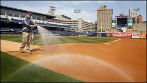 Jake Tyler, sports turf manager for the Toledo Mud Hens, works on getting Fifth Third Field ready for Wednesday's noon game.