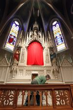 Volunteer-Mary-Adamiak-sweeps-the-floors-on-the-altar