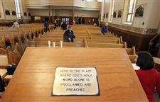 Volunteers-fan-out-in-the-sanctuary-of-St-Rose-Catholic-Church