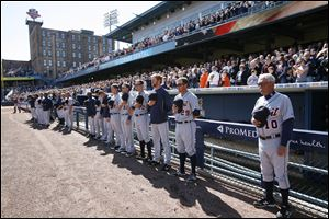 The Detroit Tigers, with manager Jim Leyland, right, stand during the national anthem before Wednesday's game at Fifth Third Field.
