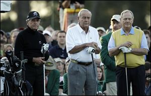 Honorary players, from left, Gary Player, Arnold Palmer and Jack Nicklaus wait to tee off on the first hole Thursday before the first round of the Masters golf tournament in Augusta, Ga.