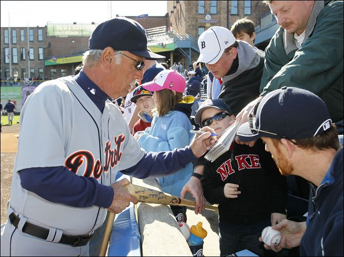 JIm Leyland Tigers manager Jim Leyland, a Perrysburg native, signs autographs before the exhibition game at Fifth Third Field. The Tigers started their regular linup.