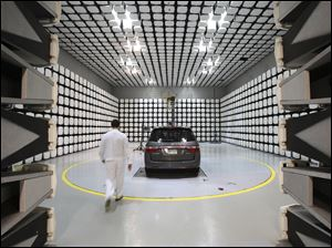 A engineer walks into the radio frequency shielding chamber at Honda Research & Development in Raymond, Ohio.