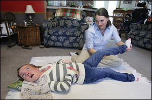 Brianna Burkett of Gibsonburg works with physical therapy assistant Rebecca BeVier.