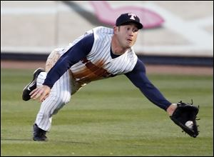 Toledo right fielder Matt Young (6) makes a diving catch  against Louisville during the sixth inning.