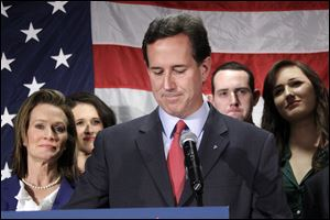 Surrounded by members of his family Republican presidential candidate, former Pennsylvania Sen. Rick Santor